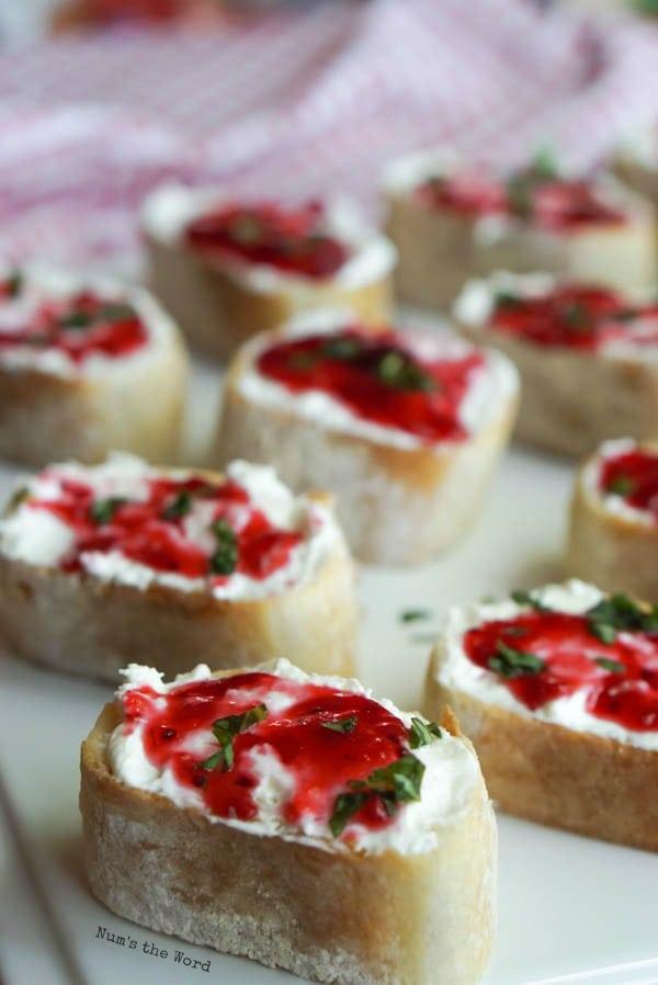 Leftover Cranberry Sauce Bruschetta - bruschetta on a serving platter ready for a party