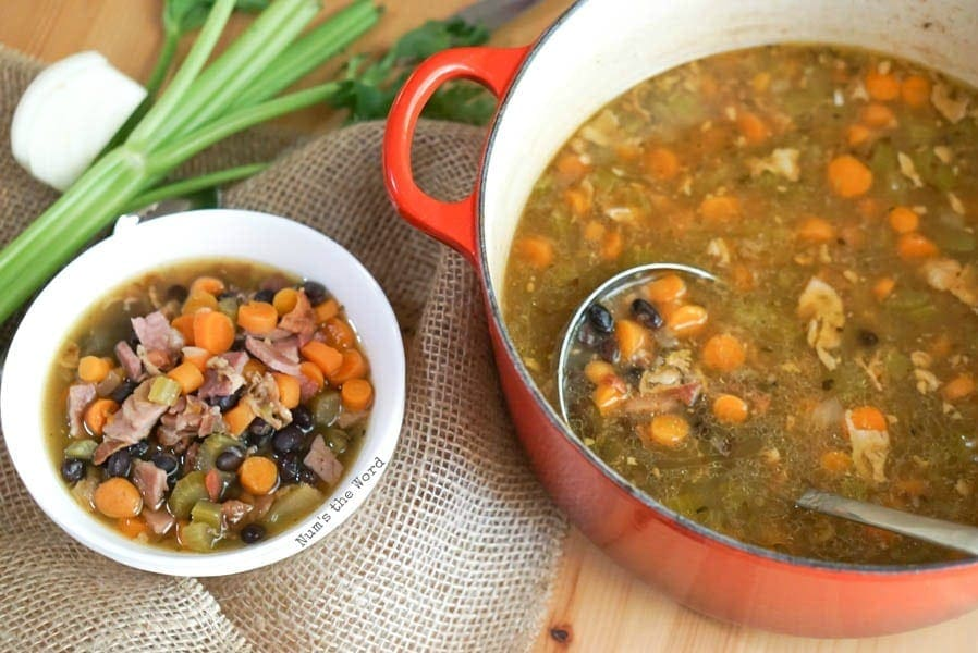 Ham Bone & Vegetable Soup - bowl of soup next to pot of soup