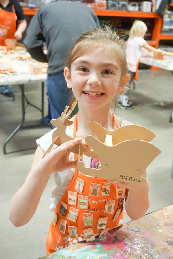 Home Depot Kids Workshop - smiling face showing off the project that is now built
