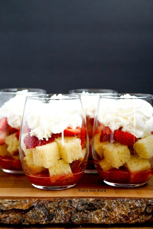 Strawberry Shortcake Trifle Cups - whipped cream placed on top of sliced strawberries