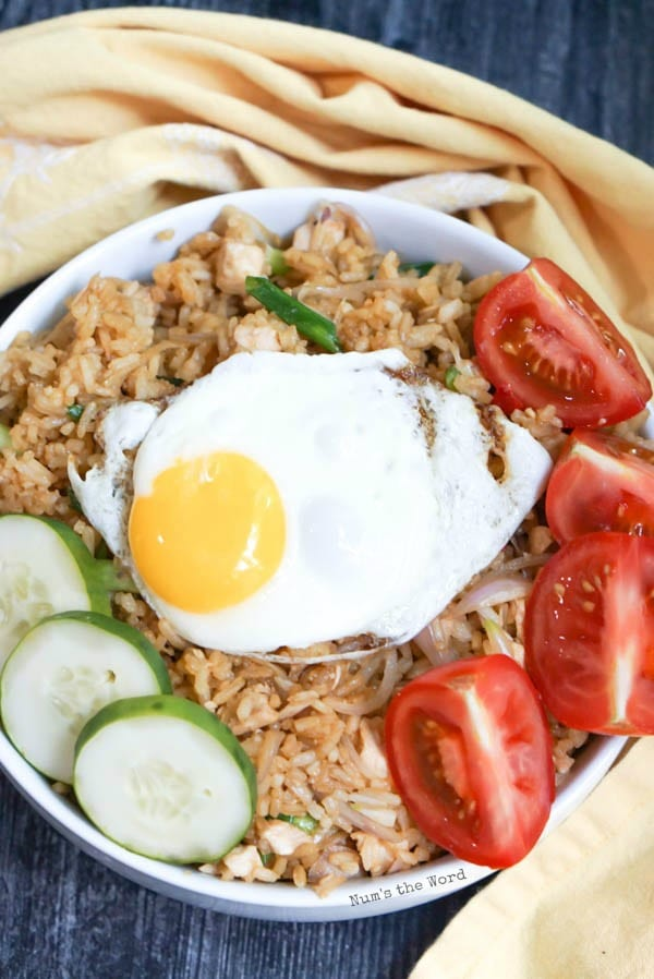 Indonesian Fried Rice - Fried egg, tomatoes and cucumbers on top of rice