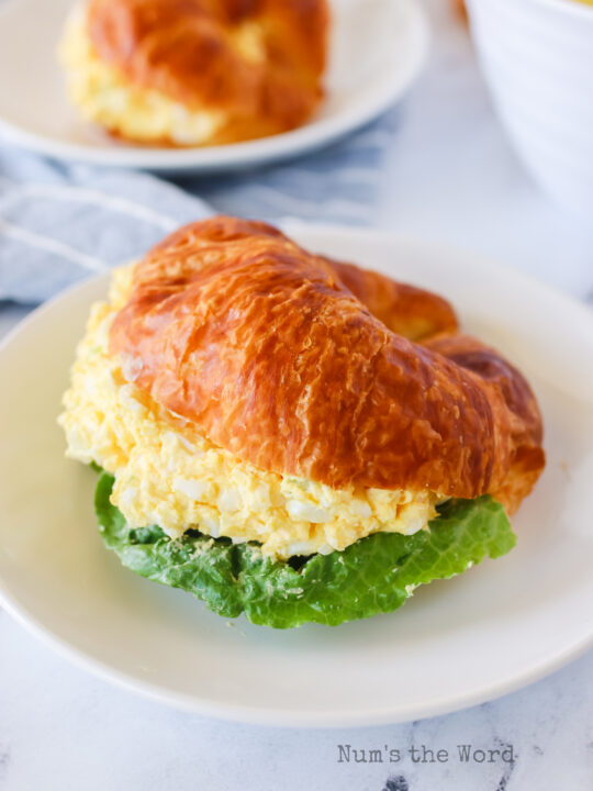 egg salad on a croissant with lettuce