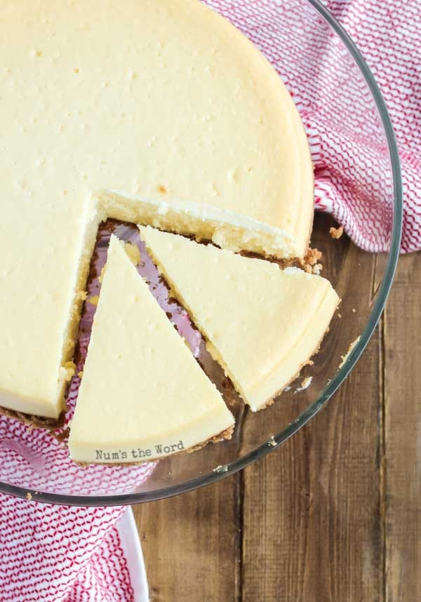 Easy Cheesecake Recipe - cheesecake on platter with two slices cut