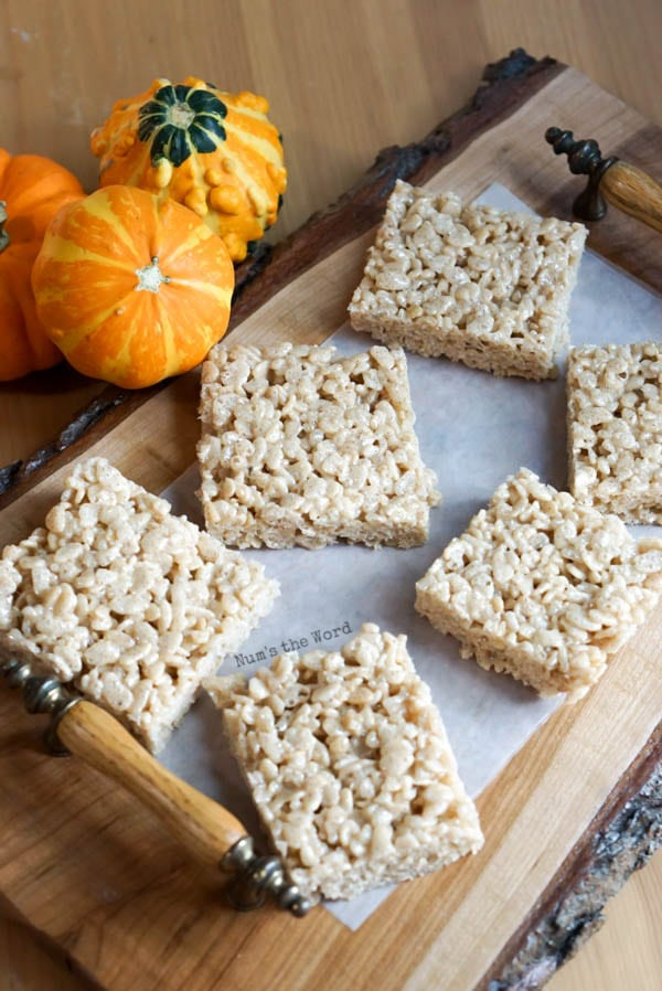 Pumpkin Spice Rice Krispies - treats cut into squares and placed on a platter