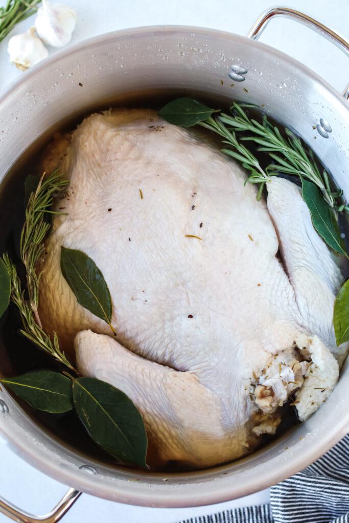 Close up photo of turkey sitting in salt brine