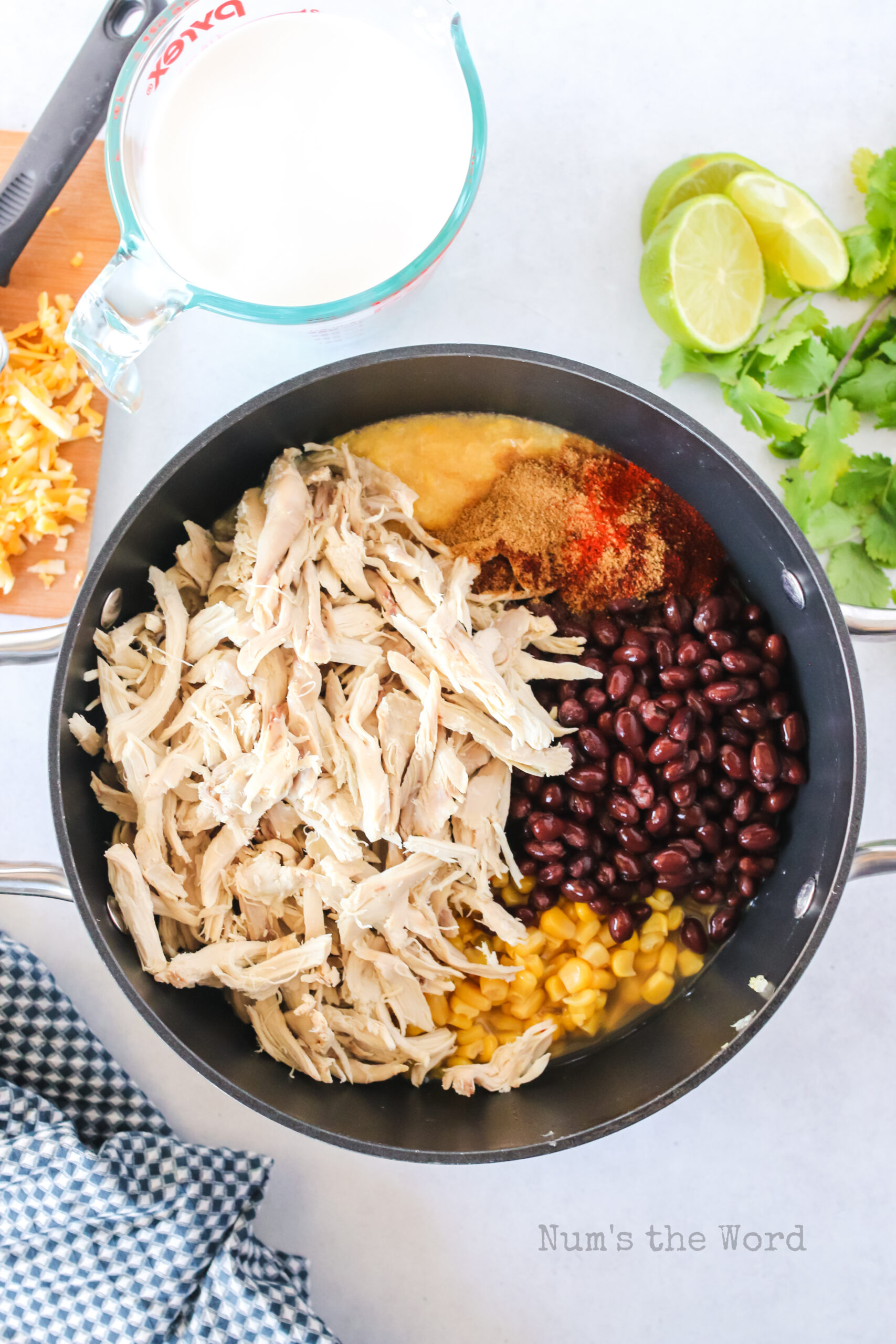 chicken, garlic, broth, corn, cream corn, black beas, chipotel powder, paprika, cumin all added to pan.