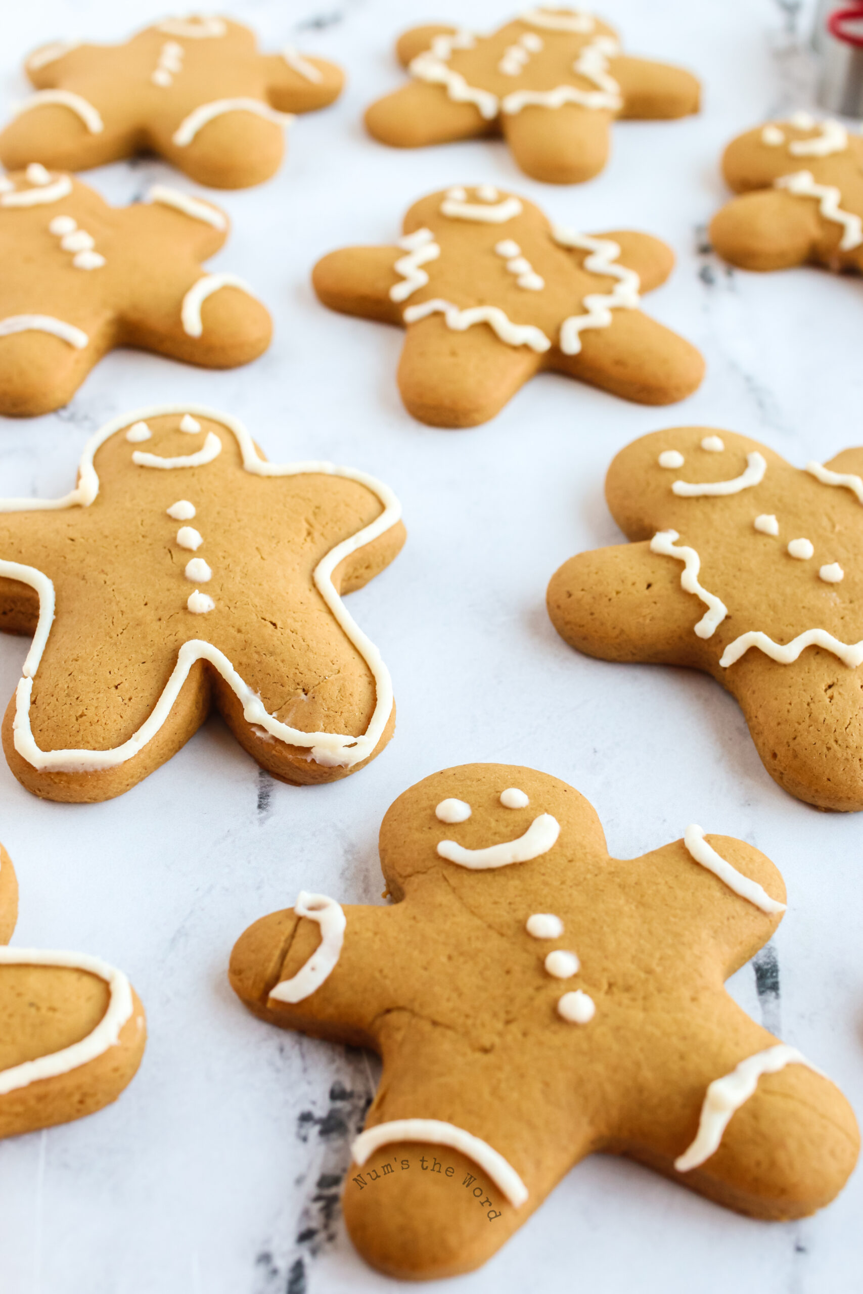 top side view of decorated gingerbread cookies on parchment paper