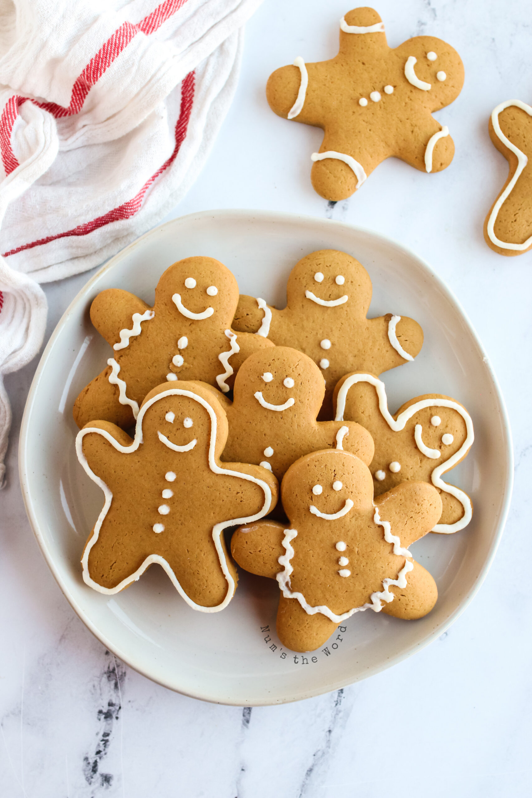 decorated gingerbread cookies on a plate ready to be eaten