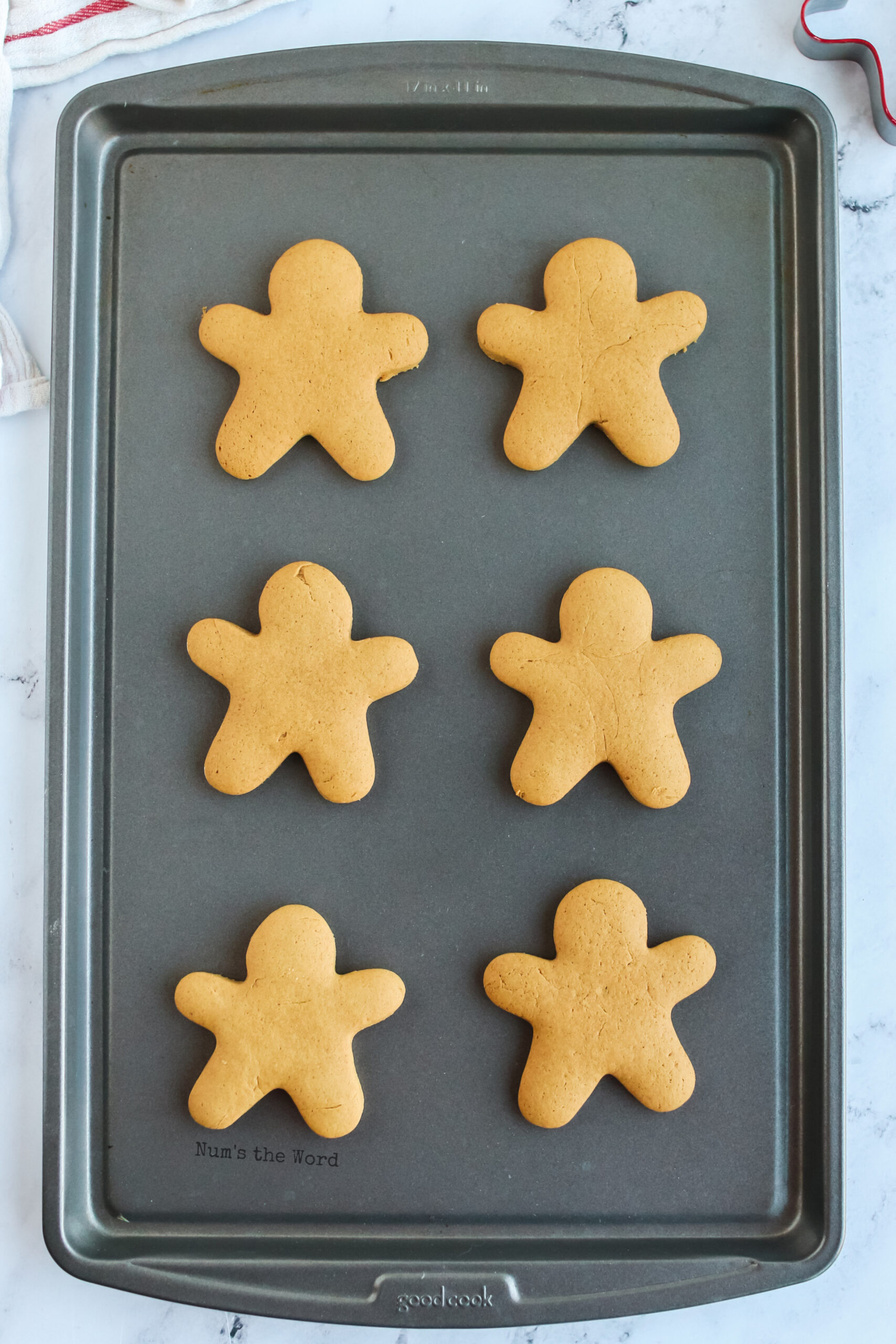 fresh baked gingerbread cookies on a cookie sheet - view from the top