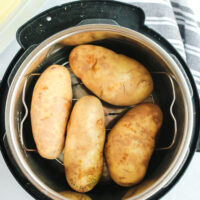 4 unbaked potatoes placed into an instant pot