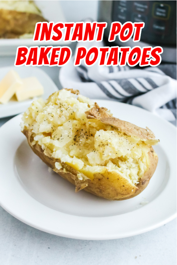 Main image for recipe of single baked potato on plate, sliced in half and fluffed.