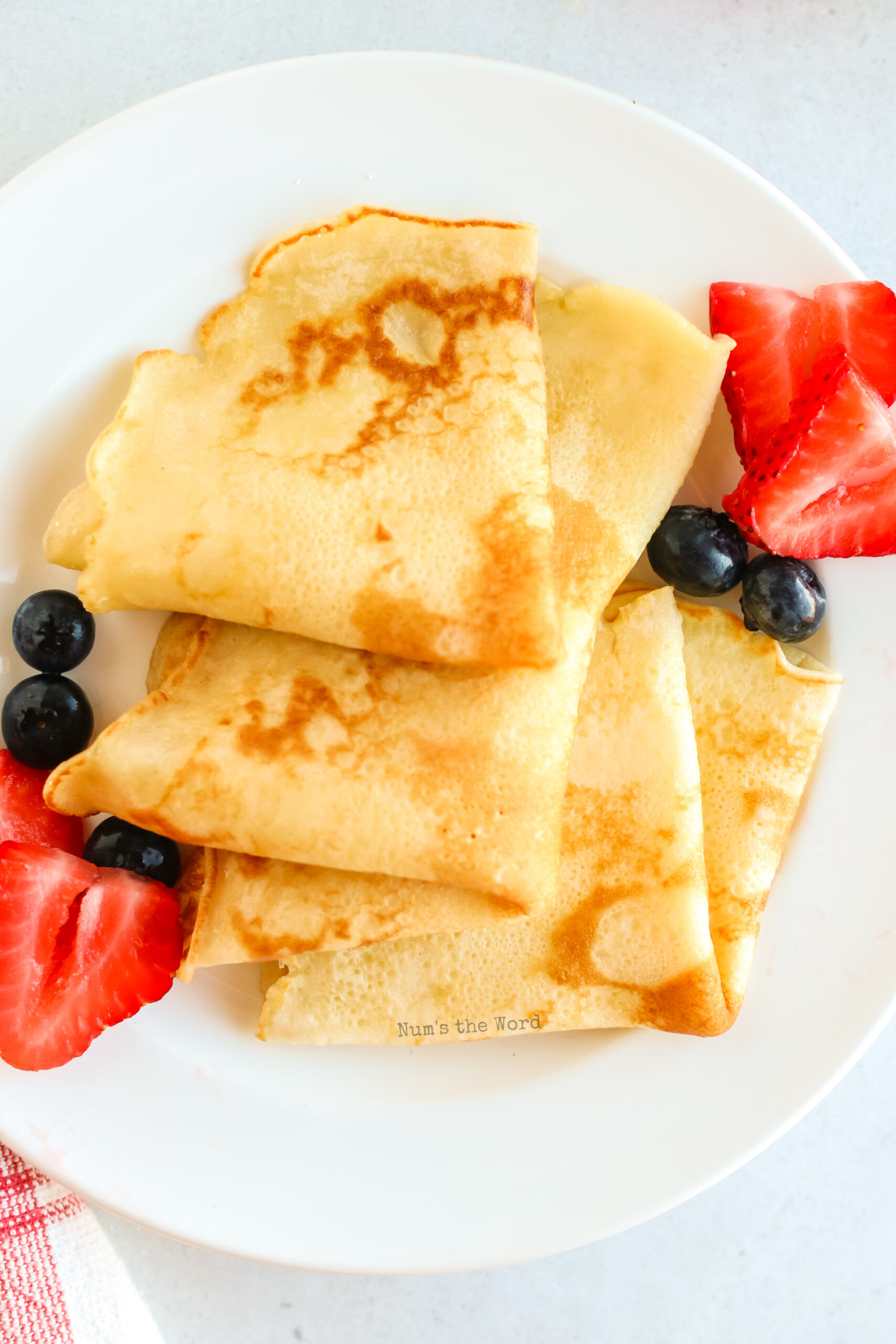 close up image of pancakes folded into triangles
