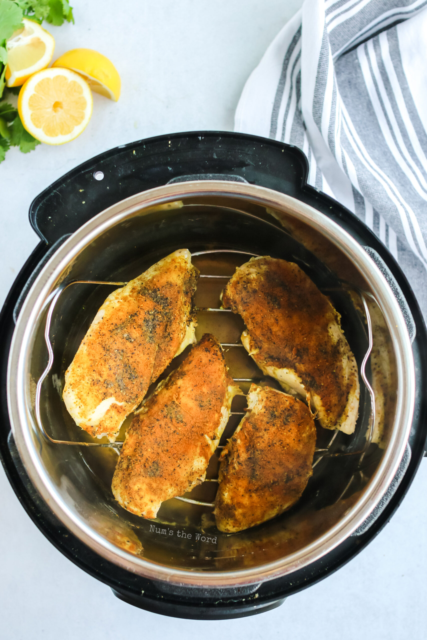 seasoned and cooked chicken inside instant pot