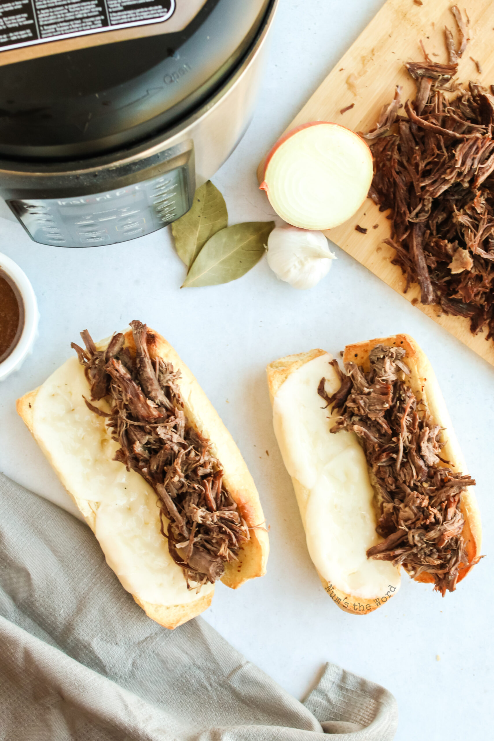 shredded beef place on sandwich buns