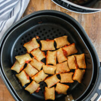 cooked air fryer pizza rolls in air fryer pan