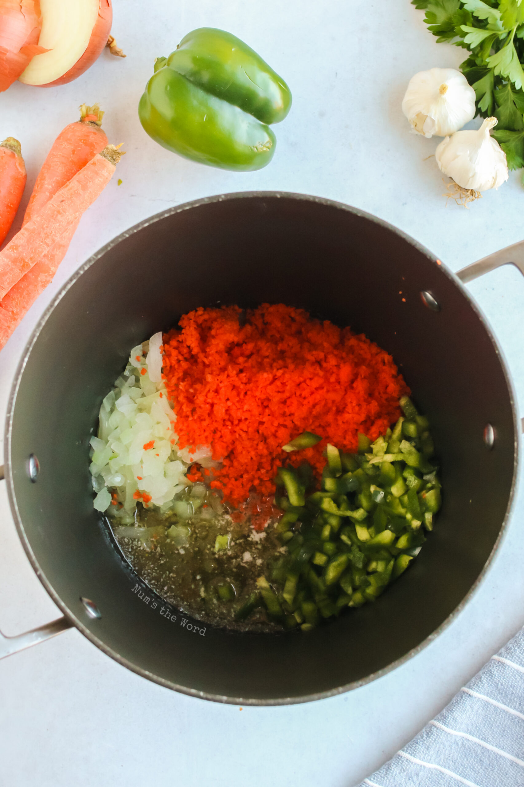 onion, carrots and bell pepper added to butter in pot