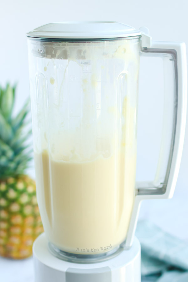ice cream, pineapple and pineapple juice in blender, mixed up