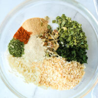 ranch seasoning ingredients in a bowl, not mixed together.