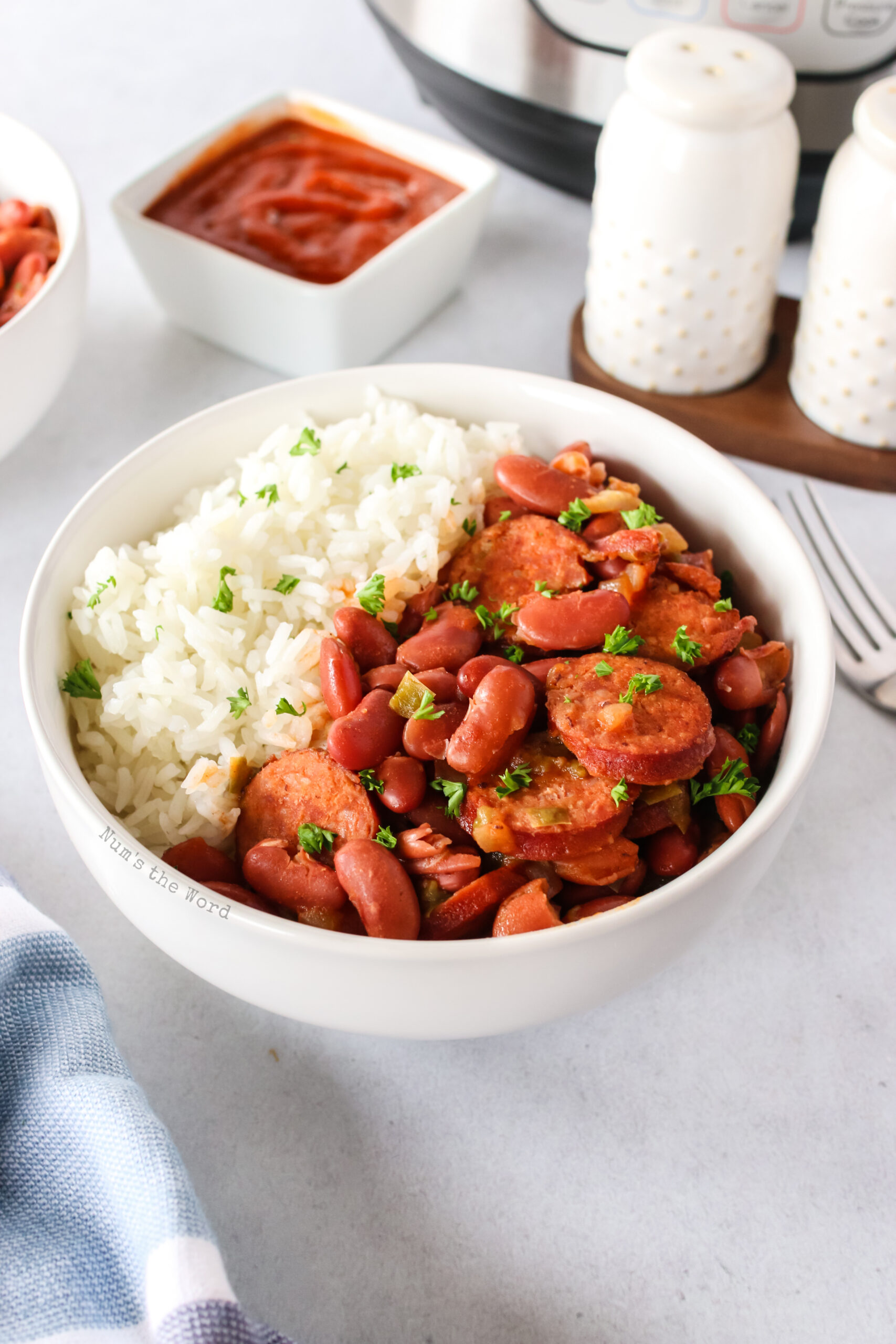 side view of red beans and rice in a bowl
