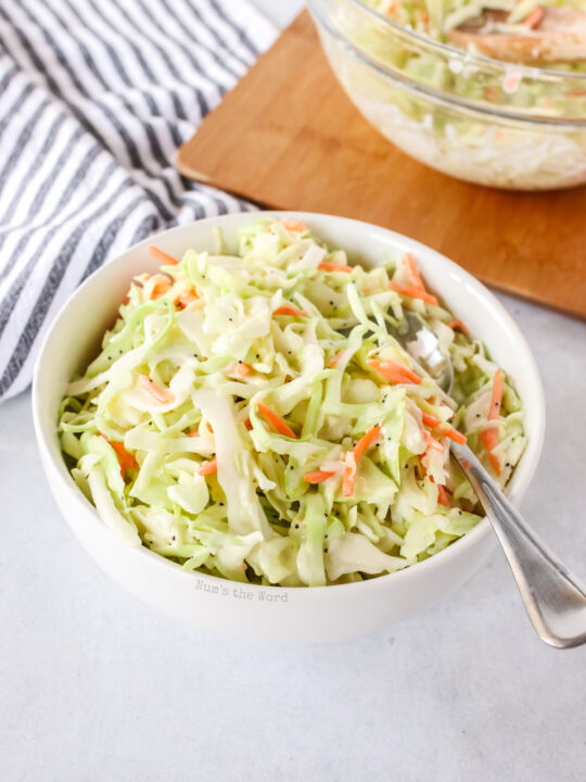 coleslaw in a bowl ready to eat with a spoon