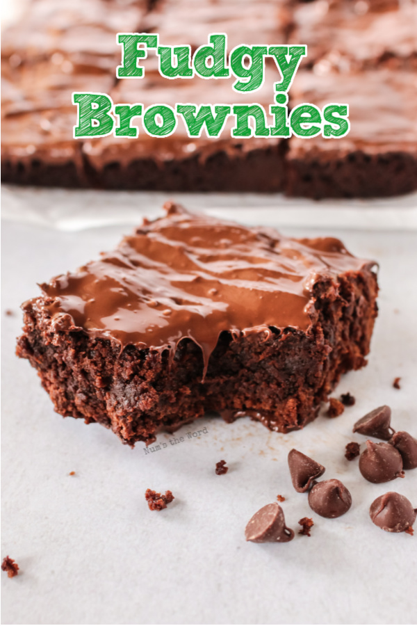 Main image of fudgy brownies. single brownie on plate with remaining brownies in the background.