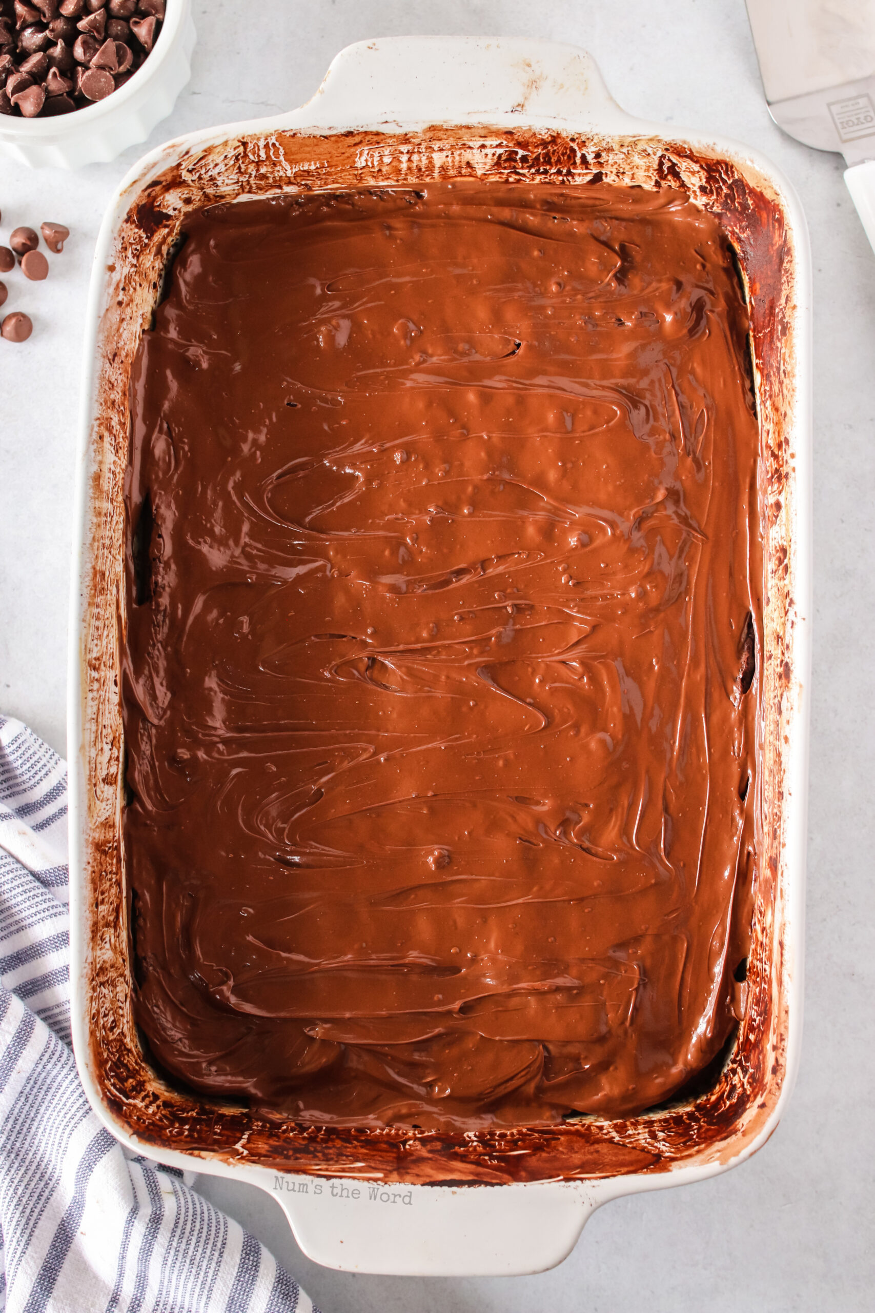 chocolate chips melted and spread over the top of brownies.