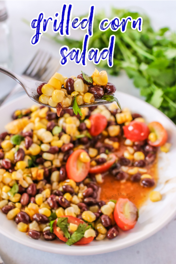main image for recipe of grilled corn salad on a plate with fork full.