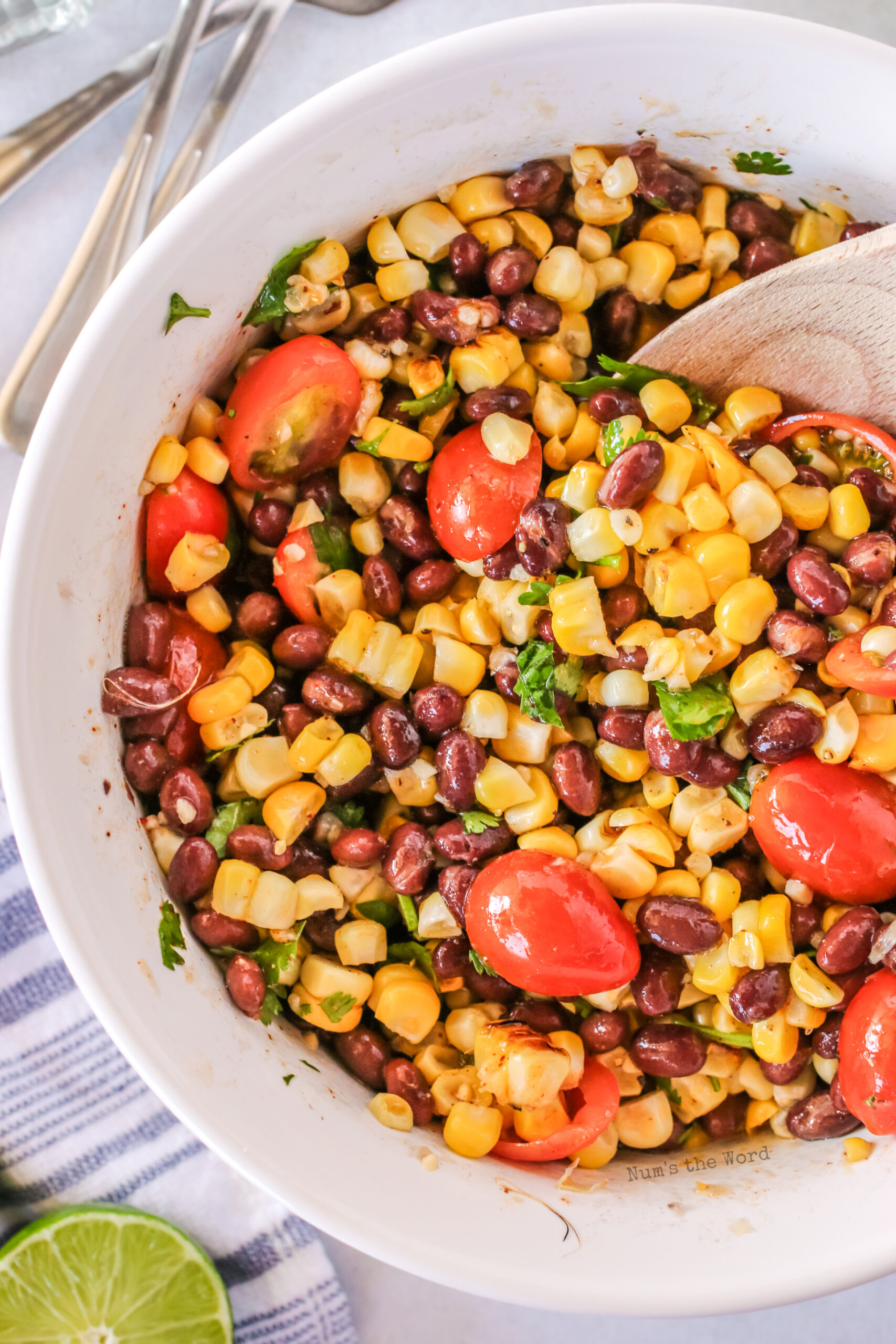 grilled corn salad with dressing in bowl, zoomed in photo.