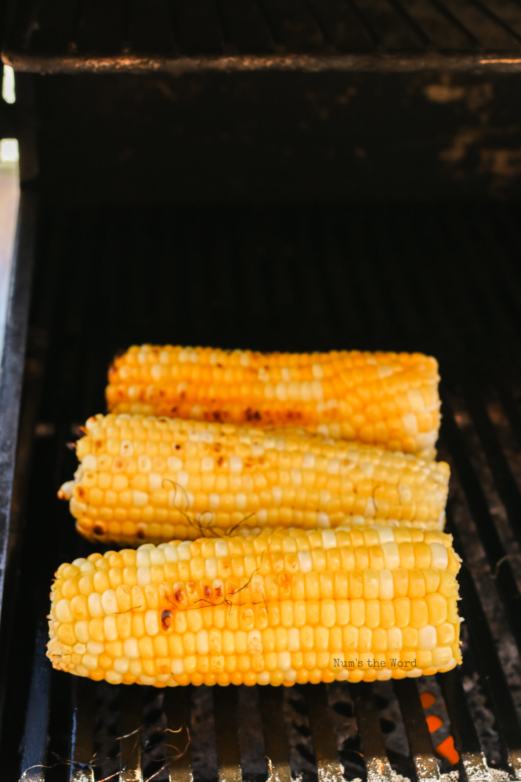 corn cobs removed from foil and charred on grill.