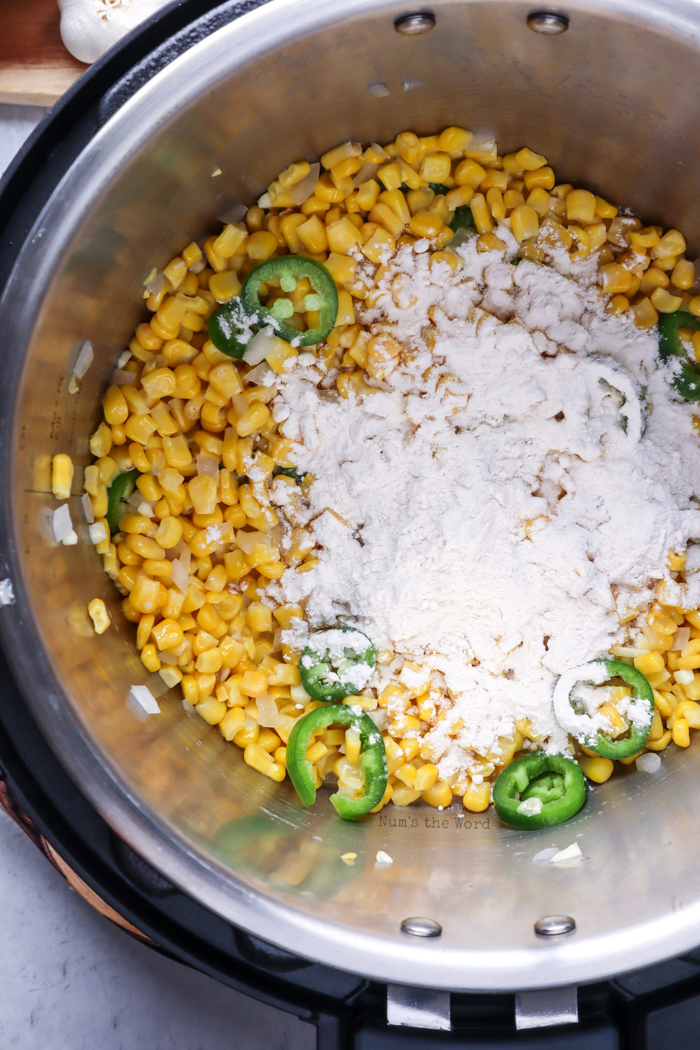 flour and elote seasoning added to corn mixture.