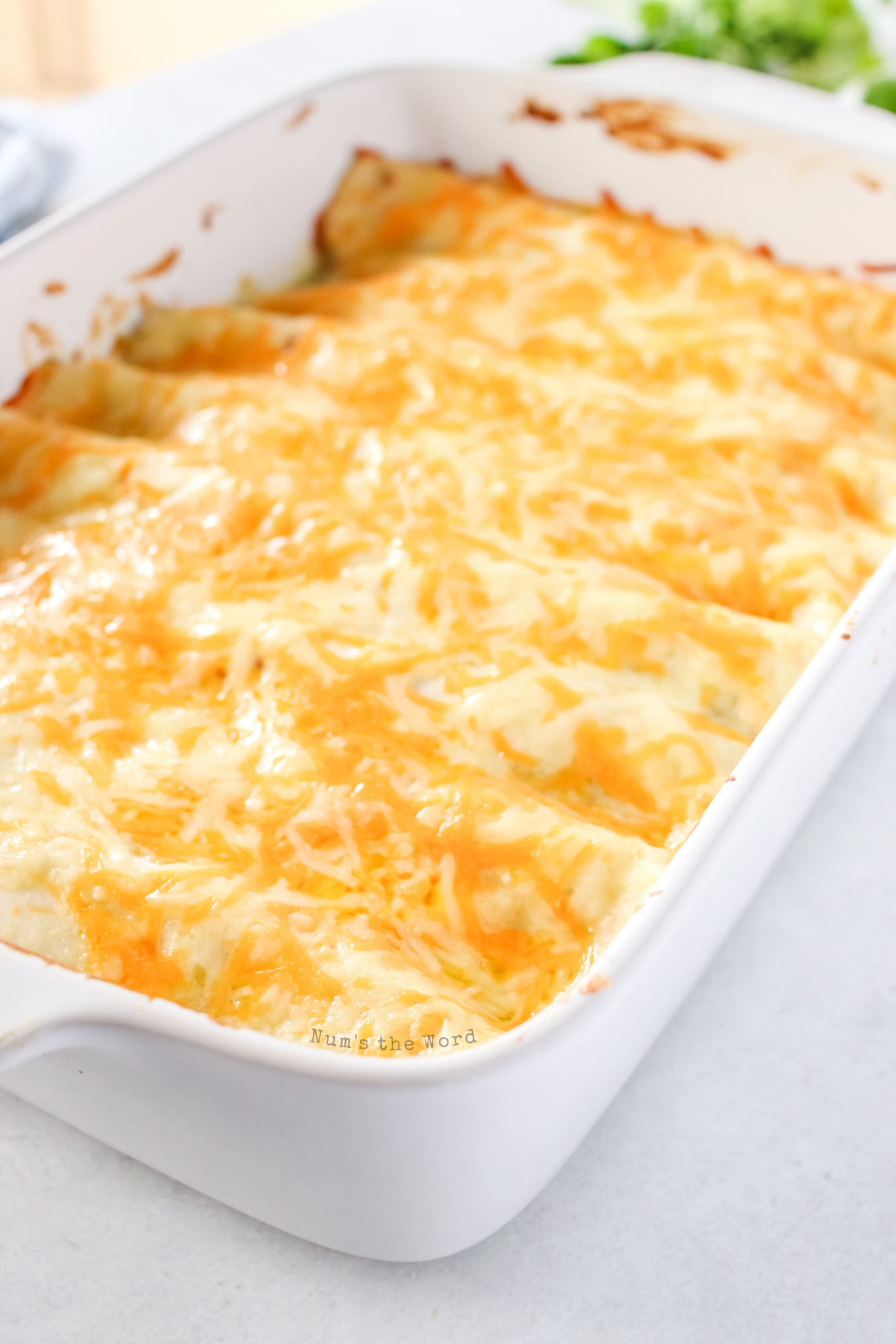 cooked enchiladas in casserole dish, ready to serve.