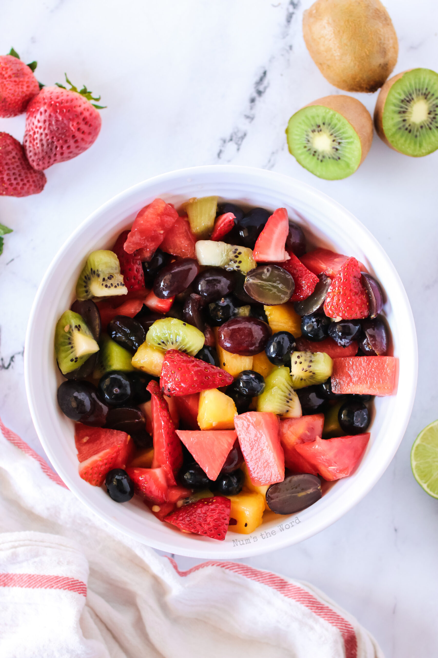 zoomed out image of fruit salad in a bowl.