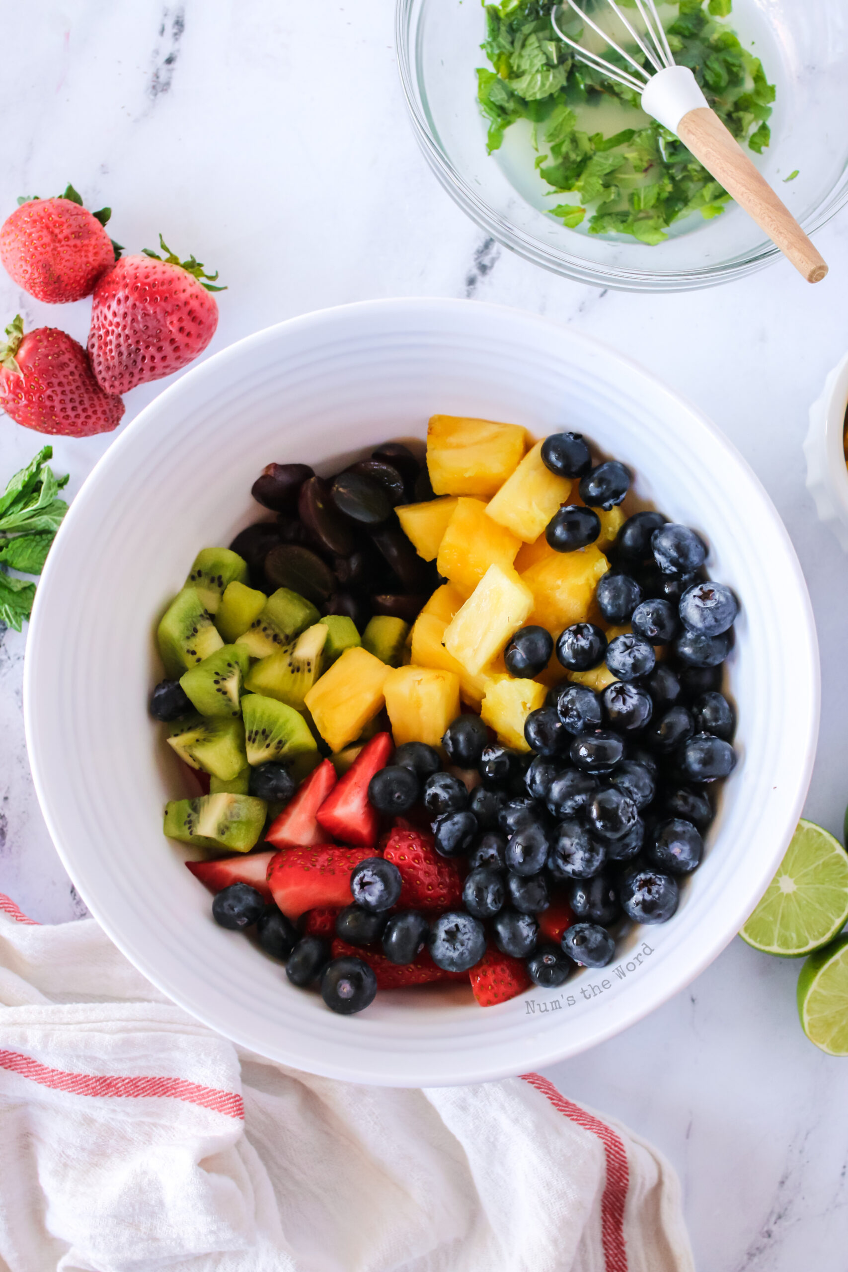 all cut fresh fruit in a bowl, not mixed.