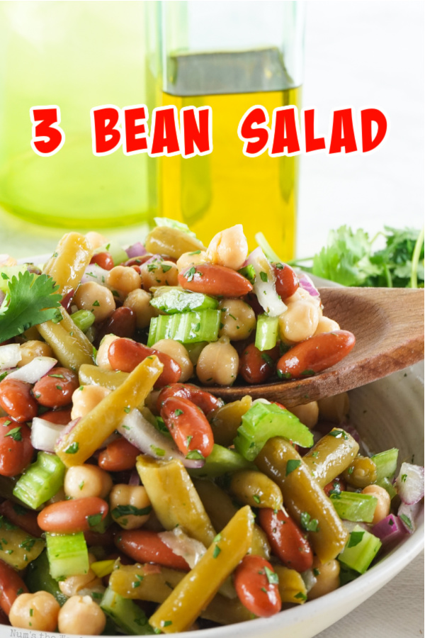 Main image for recipe of 3 bean salad with a wooden spoon scooping some out.