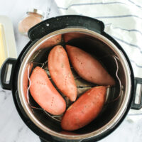 4 sweet potatoes in the instant pot, ready to cook.