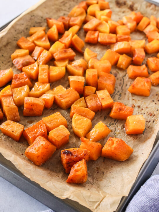 side angle of squash on cookie sheet ready to serve