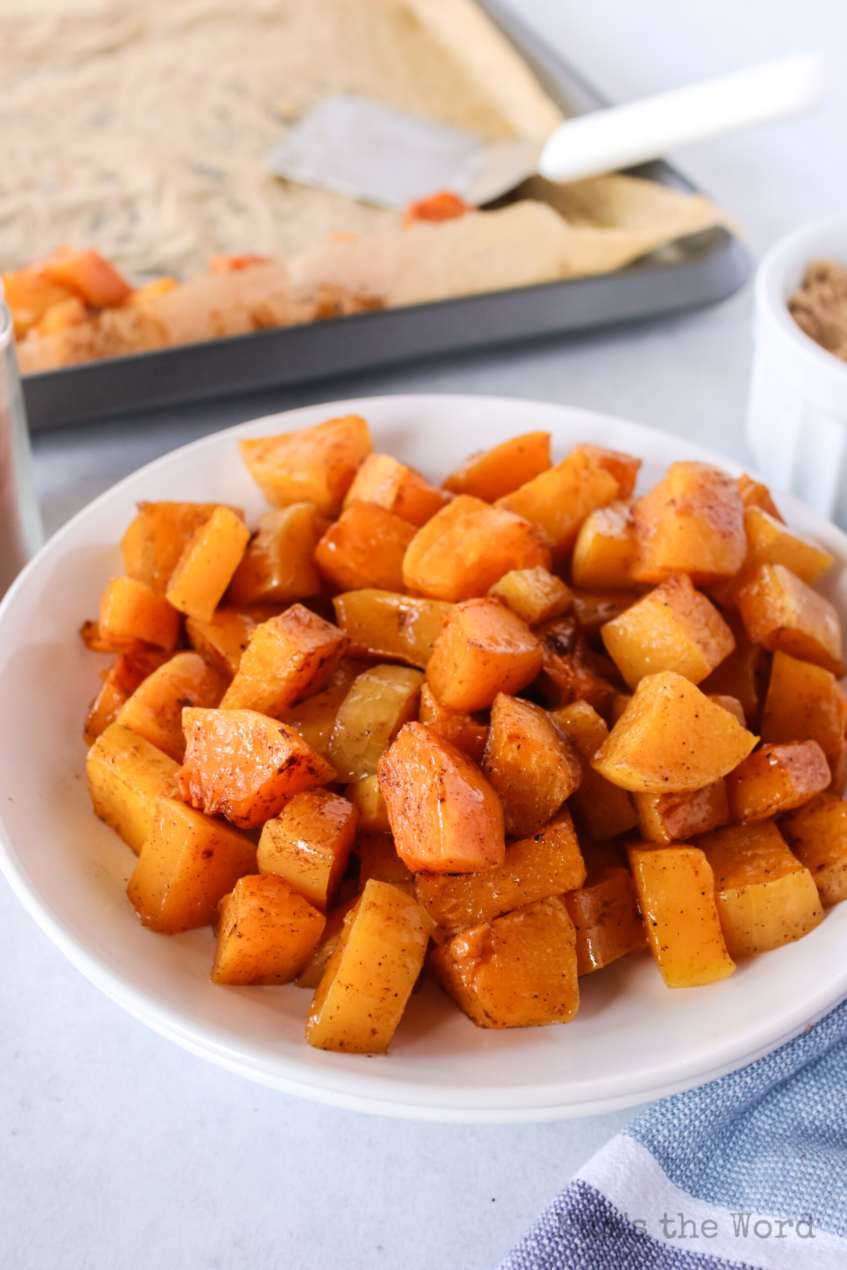 side angle of roasted squash in a bowl, ready to serve.