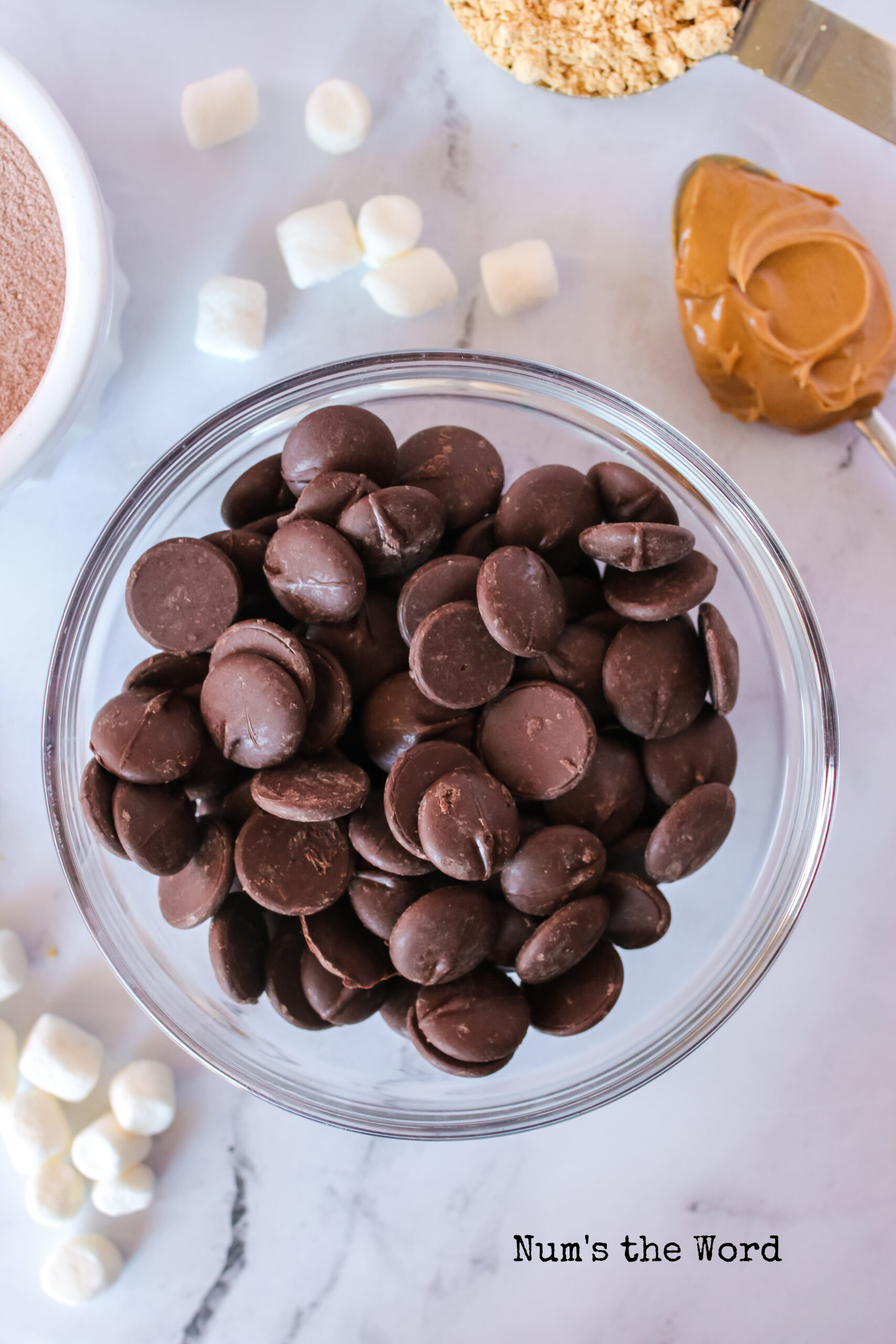 Melting chocolate wafers in a bowl, not melted.